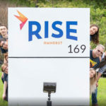 Sign and Team Members at Rise Amherst Dispensary - Credit: Rise