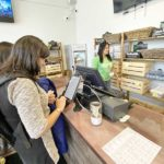 Using the Digital Menu at Pure Oasis's Dorchester Dispensary - Credit: Spencer Buell (Boston Magazine)