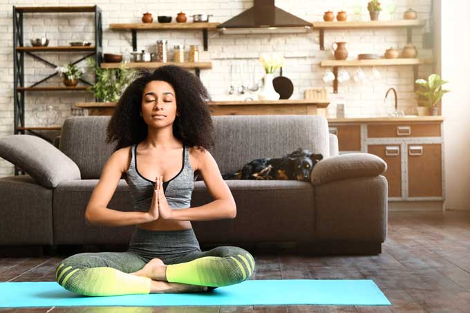 Picture of Woman Doing Yoga, Strains to Relax