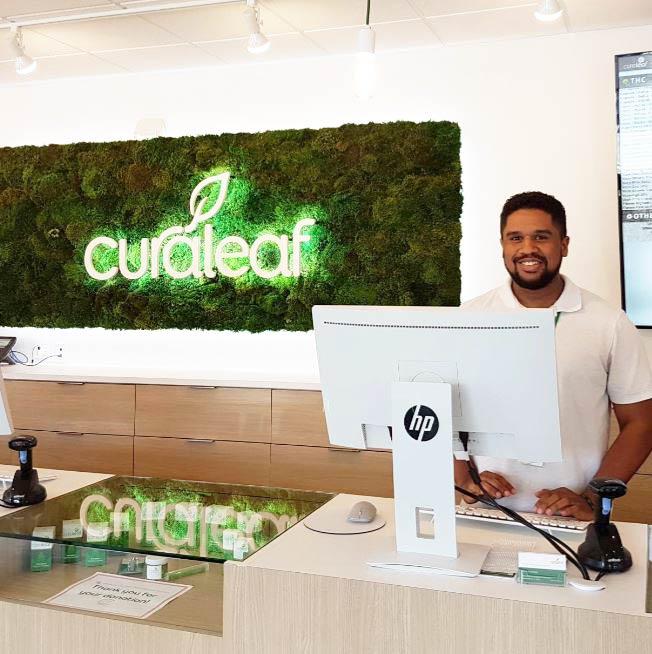 Sales Counter Staff at Curaleaf's Daytona Dispensary - Credit: Curaleaf